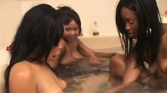 Caffene and Charisma enjoy their strap-on then join their friend in the bath